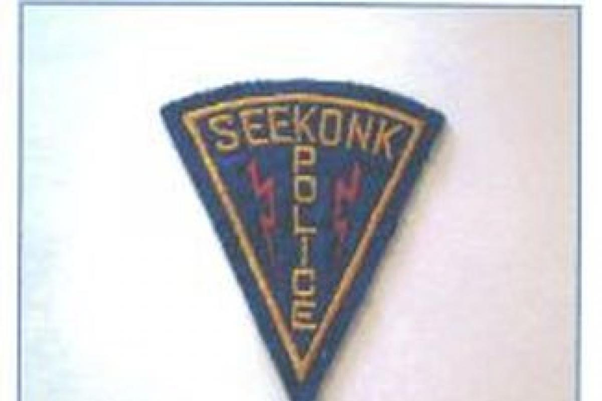 A Seekonk Police Patch depicting lighting bolts
